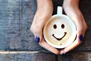 Coffee with a chocolate smiley