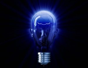 Image of a lightbulb in shape of a human head with blue light as metaphor for what is a soul